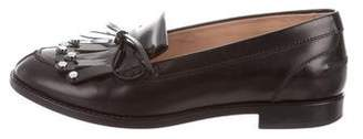 Tod's Studded Kiltie Loafers
