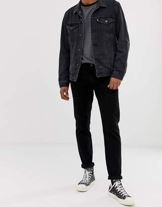 Levi's 501 slim tapered low rise jeans in black black overdye