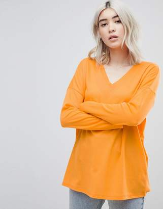 Asos Design DESIGN top with v-neck in oversized lightweight rib in orange