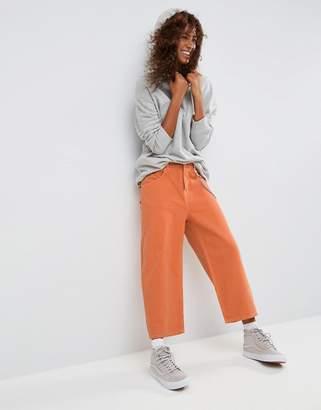 Asos DESIGN Crop Skater Jeans in Washed Orange with Contrast Stitch