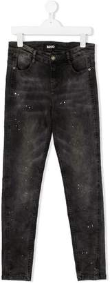 Molo TEEN paint-splattered slim fit jeans