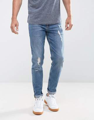 Asos DESIGN Stretch Slim Jeans In 12.5oz Mid Wash Blue With Rips