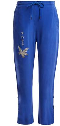 MHI Eagle-embroidered silk trackpants