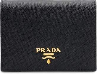 c6d58fd21c50 where to buy prada saffiano leather flap wallet with enamel triangle logo  black 49a0a a6bf3; spain at farfetch prada small leather wallet c433d cbb7f