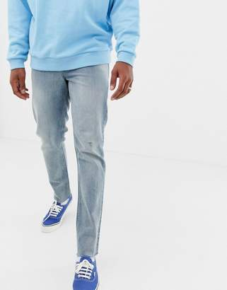 Asos DESIGN 140z heavy weight slim jeans in vintage light wash with abrasions