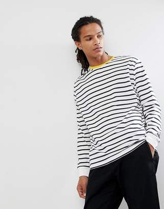 Asos DESIGN stripe relaxed long sleeve t-shirt in white and navy with contrast ringer