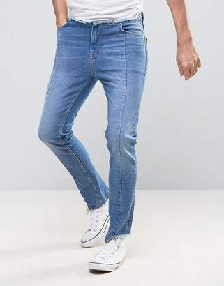 ASOS High Waisted Skinny Jeans With Raw Stepped Hem and Waistband in Mid Blue $53 thestylecure.com