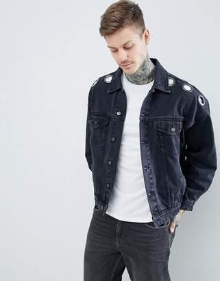 Asos DESIGN oversized denim jacket with eyelets in washed black