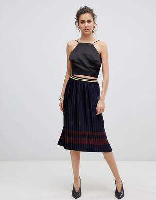 B.young metallic pleated skirt