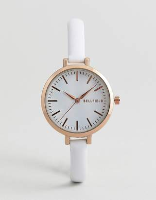 Bellfield Watch With Gold Case And Thin White Strap