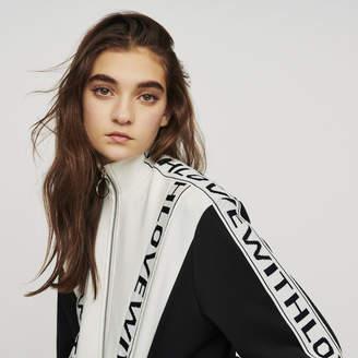Maje Zipped sweatshirt with slogan band