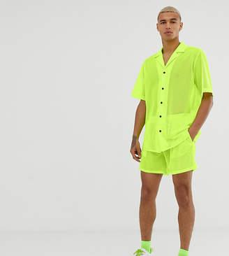 Reclaimed Vintage festival fluorescent mesh shorts