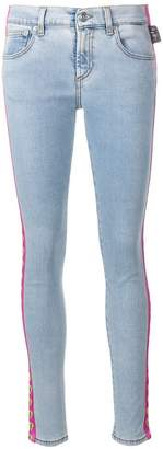 Versus logo stripe skinny jeans