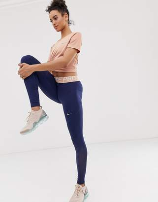 Nike Training Pro Training Leggings In Navy With Rose Gold waistband