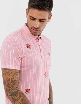 Asos Design DESIGN vertical striped polo with rose embroidery