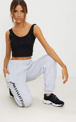 PrettyLittleThing Black Button Front Rib Crop Top