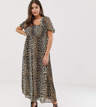 Asos DESIGN Curve shirred bustier maxi dress with puff sleeve in animal print