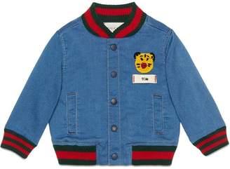 763b961f9dbc6 Gucci Kids Baby jersey denim bomber jacket with patch