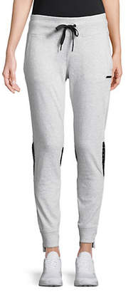 Calvin Klein Slim-Fit Mesh Eyelet Jogger Pants