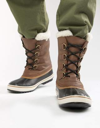 Sorel Pac snow boots in brown leather