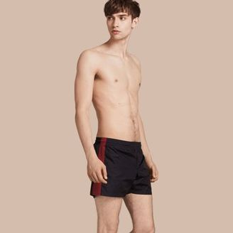 Burberry Stripe Detail Swim Shorts $295 thestylecure.com