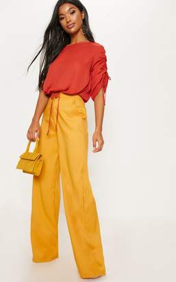 PrettyLittleThing Rust Chiffon Ruched Sleeve Detail Drawstring Crop Top