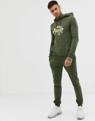 Asos DESIGN tracksuit muscle hoodie/super skinny joggers with tiger print in khaki