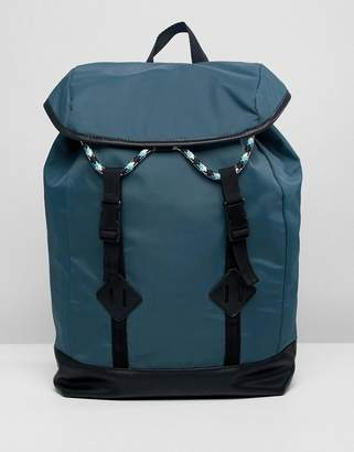 Asos DESIGN backpack in green with double strap and colored drawcord