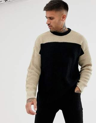 Bershka knitted sweater in black with camel color blocking