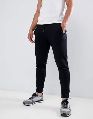 Emporio Armani logo sweat joggers in black