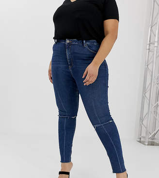 Asos DESIGN Curve Ridley high waisted skinny jeans in dark wash blue with ripped knee detail