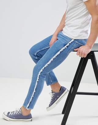 Asos DESIGN Skinny Jeans in Mid Wash Blue With Frayed Side Stripe