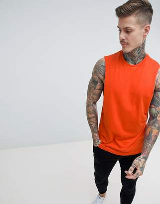 Asos DESIGN tank with dropped arm hole in red