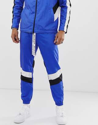 Religion tracksuit joggers in blue