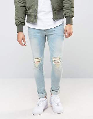 Asos DESIGN Super Skinny Jeans With Knee Abrasions In Bleach Blue