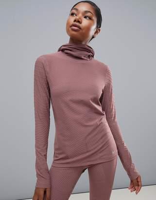 Nike Running long sleeve hooded top in peach