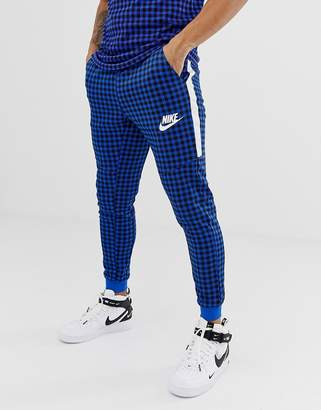 Nike Gingham Check Joggers In Blue BQ0676-480