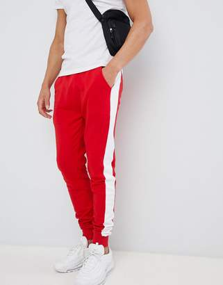 Asos Design DESIGN skinny joggers with side stripe in red