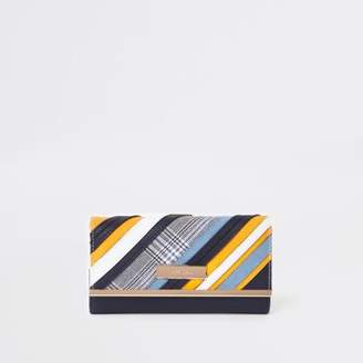 River Island Blue mixed print cutabout clip top purse