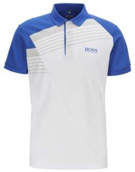 Moisture-wicking polo shirt with engineered stripes