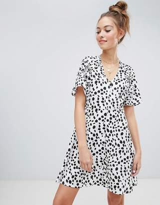 Wednesday's Girl button front tea dress with tie back detail in dalmation spot