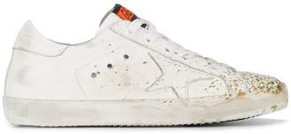 Golden Goose paint splatter Superstar leather sneakers