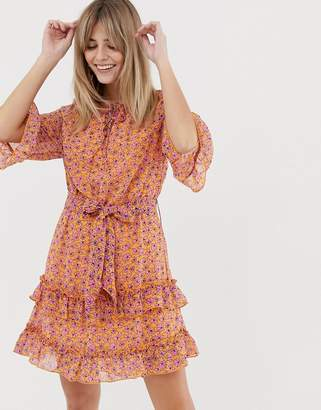Vero Moda floral mini dress with ruffle hem in orange