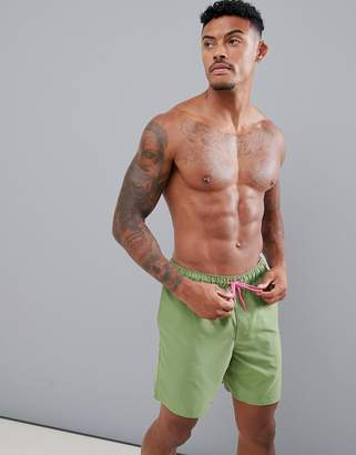 Asos DESIGN swim shorts in khaki with neon pink drawcord mid length