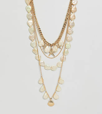 Asos DESIGN Curve exclusive multirow necklace with shell and pearl charms in gold