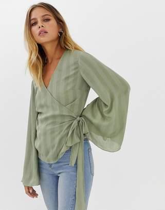 Asos Design DESIGN wrap long sleeve top in crinkle