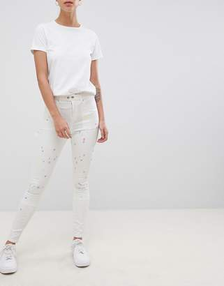 styling/ ASOS DESIGN Ridley high waist skinny jeans with painter styling in pax painted wash