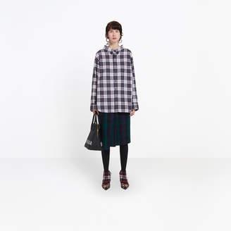 Balenciaga Swing tartan shirt, delicately uncovers the neckline