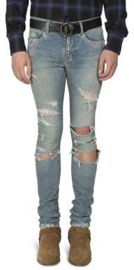 Saint Laurent Distressed Straight-Fit Jeans $850 thestylecure.com