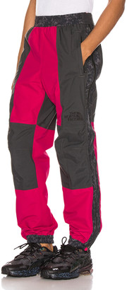 The North Face Black 94 Rage Rain Pant in Rose Red & Asphalt Grey | FWRD